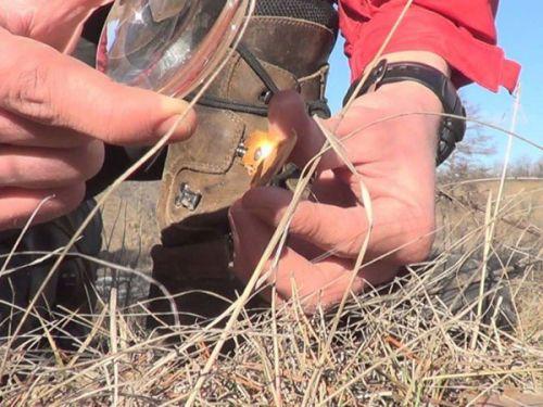 Добывание огня с помощью линзы