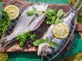 Рыба с лимоном и зеленью